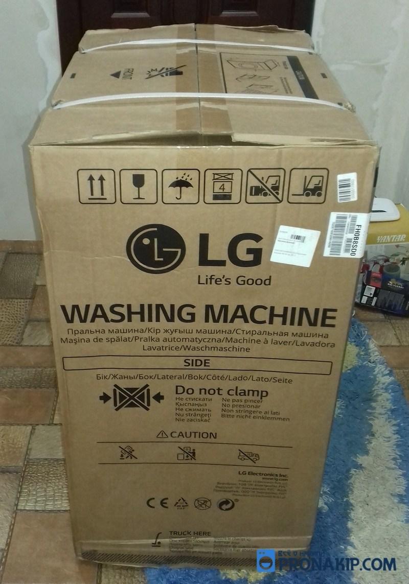 Упакованная стиральная машина